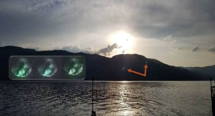 Three transparent Spheres with figures inside caught over Lake Okanagan, Canada 1_31