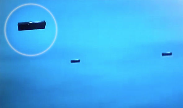 Oblong objects caught in high def on NASA cam spark online frenzy Ufo-cube-906589_orig